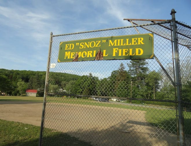 """The Ed """"Snoz"""" Miller sign, on the north ballfield near the Hudson Street and Main Avenue corner of Bingham Park in Hawley."""