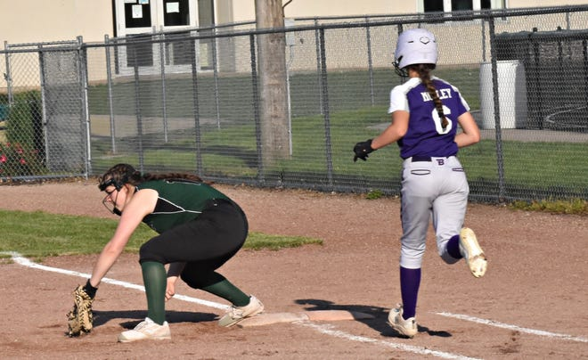 West Burlington-Notre Dame first baseman Elise Oleson digs a throw out of the dirt for the putout of Burlington's Emily Mosley (6) in the fifth inning of Tuesday's first game at Barb Carter Field. The Falcons swept Burlington, 5-4 and 8-1.
