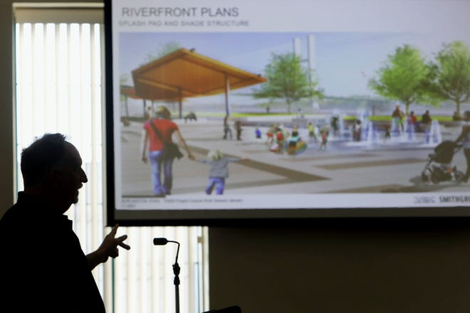 Leo Foley with Veenstra and Kimm, Inc., speaks Tuesday during a public meeting providing an update on the status of the TIGER grant design for Main and Jefferson streets and the riverfront in City Hall Council Chambers.