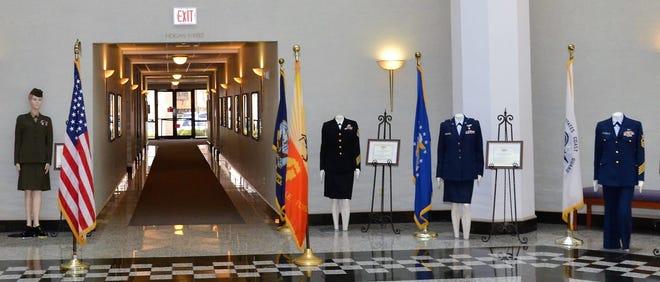 A women veterans art and uniform display in City Hall's atrium during a recent Women Veterans Recognition Week.