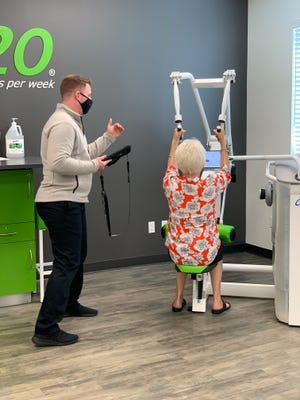 A new facility in Nocatee is the third fit20 on the First Coast. Franchise owner and trainer Conner Battreall records a client's workout with fit20's sensor technology to monitor progress.