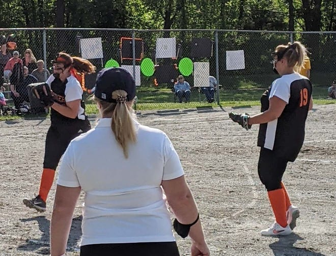 Gardner High pitcher Maddie Lashua, left, makes a running catch on an infield pop-up as the Littleton first base coach and teammate Maegan Columbus look on during Tuesday's game at Bickford Playground in Gardner.