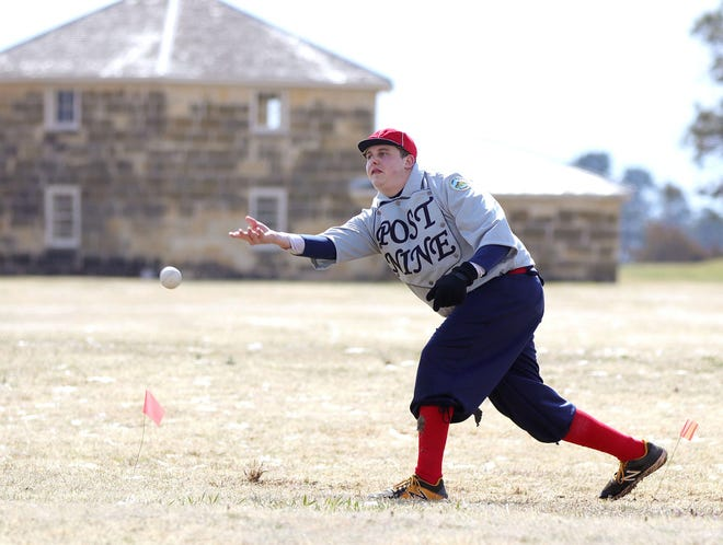 In this 2019 file photo, Justin Gottschalk pitches for the Old Fort Hays Post 9 ball team during a vintage game. Hays Larks alumni players will play the Fort Hays Post 9 team in a game featuring 1869 rules at 7 p.m. Thursday at Larks Park.