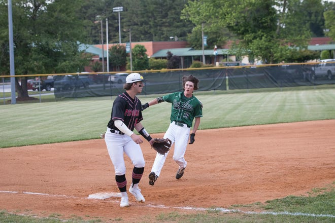East Henderson's Landon Henderson, right, makes it safely to third base on Tuesday. [PAT SHRADER/ SPECIAL TO THE TIMES-NEWS]