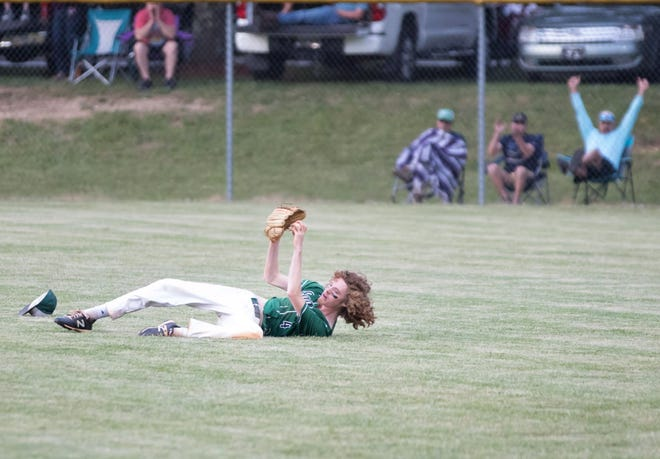 East Henderson's Jack Horton makes a diving catch against Pisgah on Tuesday night. [PAT SHRADER/ SPECIAL TO THE TIMES-NEWS]