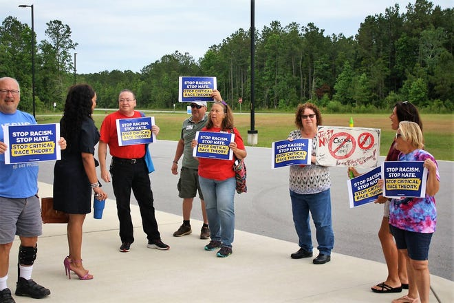 Protestors with Act Right NC speak with Onslow Board of Education remember Melissa Oakley while they gathered outside the East Regional Skills Center in Jacksonville to share their concerns about the possibility of Critical Race Theory being taught in Onslow County.