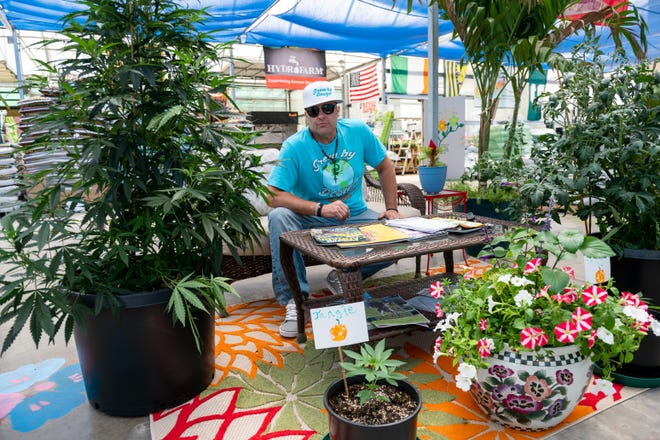 Craig Sieg, the owner of Grow by Design, sits for a portrait in his store on June 2. Sieg is planning a grand opening of the business later in June.