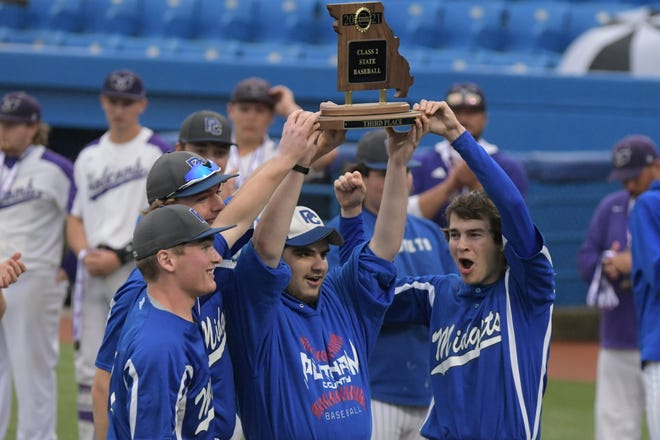 Members of the Putnam County baseball team hoist their third-place trophy after defeating Holcomb.