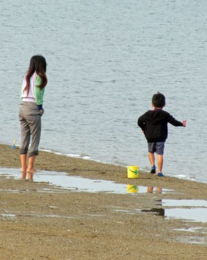 This mother and child are having a nice time exploring the beach on Castle Island.