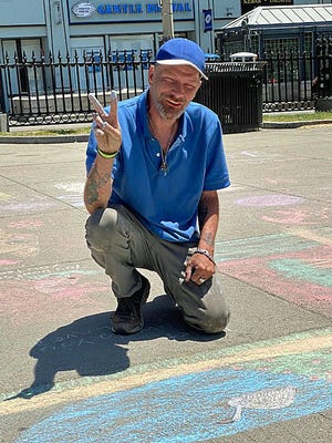 """""""Sidewalk Dennis"""" Boulet brightens up the walkways around Boston Common with his magnificent chalk art. He is following in the footsteps of the famed """"Sidewalk Sam"""" Guillemin, who began decorating the city's sidewalks in 1973 until his death in 2015. Boulet, who was encouraged by Guillemin, carries on his work."""