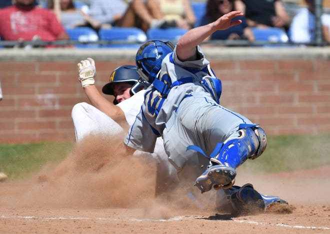 Ida catcher Aaron Dean tags an Airport runner at home plate last month. His insulin pump can be seen in his left rear pocket. Dean broke the device on this play.