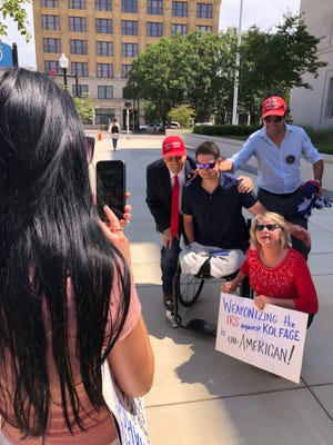 Wounded warrior Brian Kolfage poses with supporters outside the U.S. District Courthouse in Pensacola on Wednesday after pleading not guilty to federal tax charges.