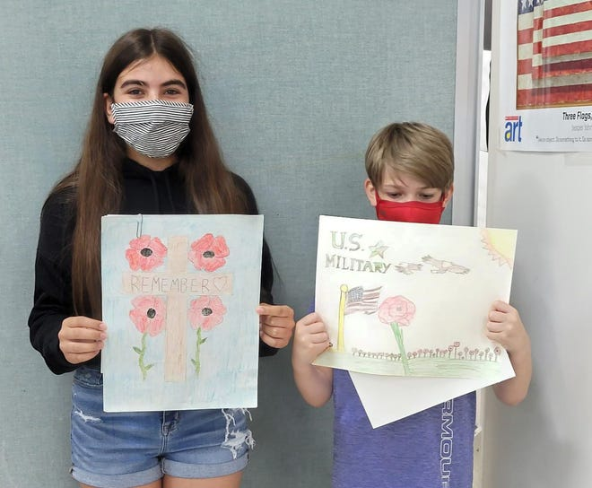 ALA Poppy Poster Contest winners from Oxford Academy Middle School were Teagan Franklin, left, and Deana Ferreira, plus Emerson La Monica who was absent from the photo.