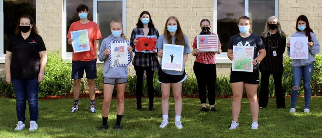 ALA Poppy Poster Contest winners from Oxford Academy High School posing with ALA Unit 376 Poppy Chairman Terrill Sutton, far left, and art educator Joni Eaton, second from right, are, from left, John Rovente, Jocie Finch, Sara Johnson, Elizabeth Knapp, Liberty Moshier, Jillian Finch and Ayla Grems.