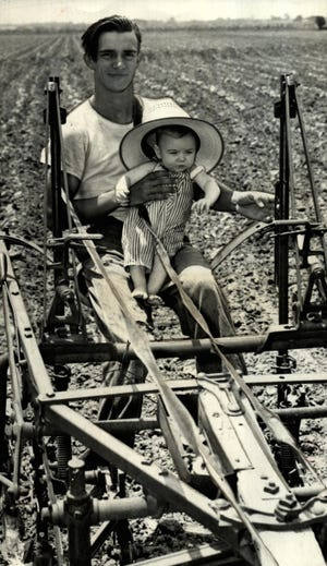 Little Kenneth Dale Handke rides a plow along with his dad, Dale Handke, appearing to help work the fields in June 1941 in Newcastle. The younger Handke had been featured as the Oklahoma City Times' 1940 Christmas baby. This photo was among multiple images of the Handke family that accompanied a story about the 6-month-old in the Oklahoma City Times.