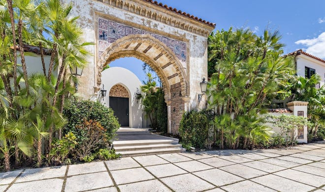 Designed by noted architect Maurice Fatio in 1930, an imposing entrance arch stands in front of a renovated 1960s-era house at 365 N. County Road, which just changed hands for a recorded $18 million in Palm Beach.