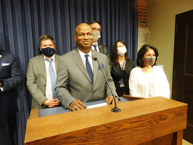 """House Democratic leadership, led by Speaker Emanuel """"Chris"""" Welch, D-Hillside, holds a news conference after 3 a.m. Tuesday at the Illinois State Capitol to talk about a recently passed state budget and other accomplishments."""