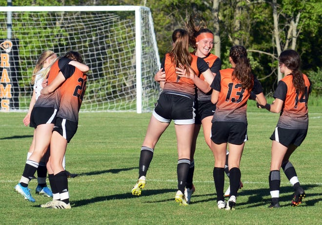 Harbor Springs players celebrate in the final seconds Tuesday at Ottawa Stadium after beating rival Charlevoix to advance in their Division 3 district and keep the season alive.