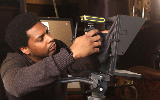 Dejuan Jordan is pictured filming the Great Lakes Chamber Orchestra.