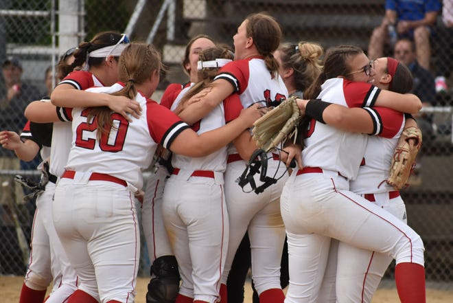 Pocono Mountain East softball players celebrate right after recording the final out of their district championship victory over No. 1 Bangor at Patriots Park in Allentown on Tuesday, June 1, 2021. East defeated Bangor 8-1 in a nine-inning thriller.