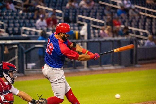 The Dominican Republic's Jose Bautista swings and misses during one of his strikeouts Tuesday night against the USA at the Ballpark of the Palm Beaches.