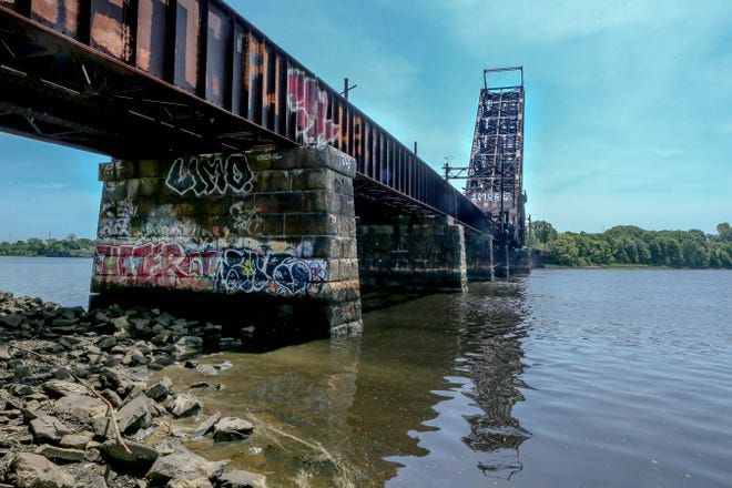 Horsley Witten Group& Jonathan Harris propose to install programmable, colored LED lights inside the upright span of the 113-year-old Crook Point Bascule rail bridge, where the railroad ties used to be.