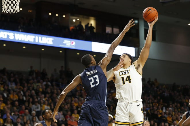 Marcos Santos-Silva, right, a native of Taunton, Mass., who formerly played for VCU, is expected to have a homecoming of sorts in December when his current team, Texas Tech, visits the Dunkin' Donuts Center for a game against Providence College.