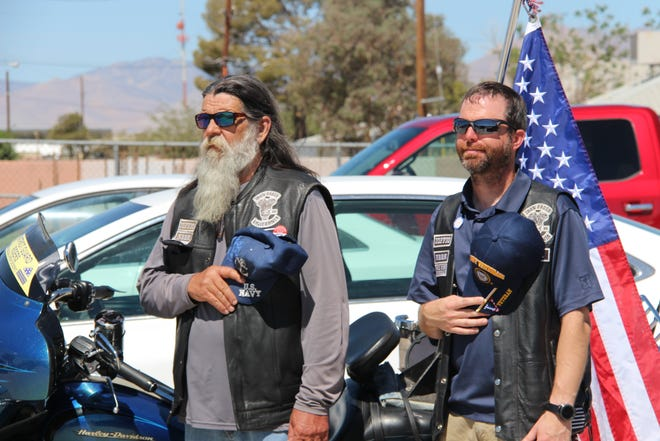 Two attendees pay their respects at the VFW and American Legion Memorial Day Observance on May 31 in Ridgecrest.