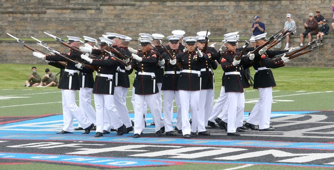 The Marine Corps Silent Drill Platoon performs Wednesday at the Pro Football Hall of Fame in Canton.