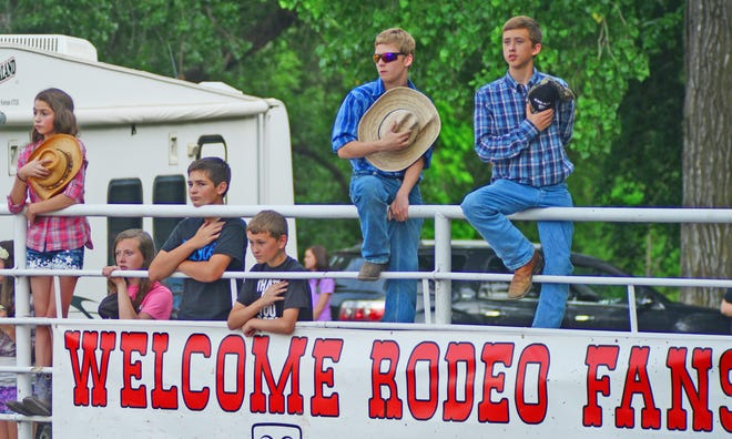 """Children pledge to the America Flag while a recording of John Wanyne's """"America, Why I Love Her"""" plays to start off the Annual Bennington Rodeo in 2015."""