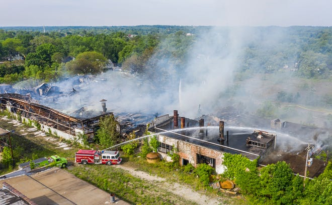 Fire crews work the scene of a fire at a vacant industrial complex on Wednesday, June 2, 2021, in Niles.