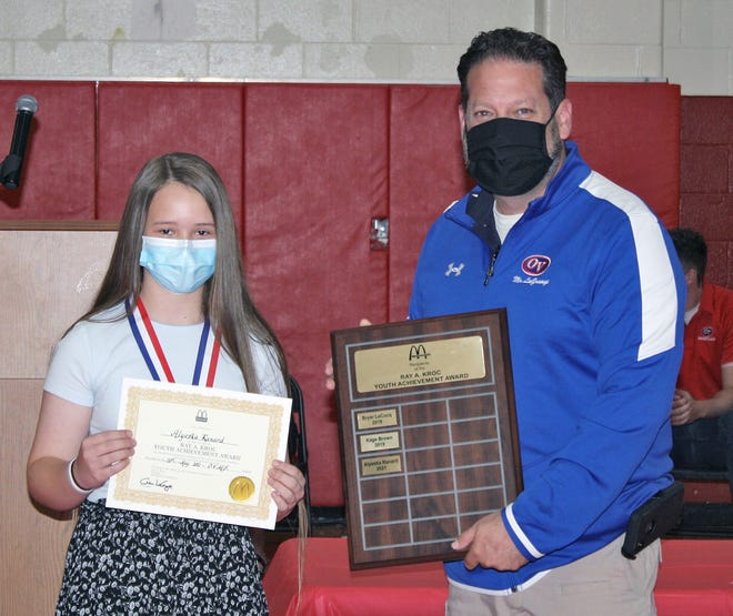 8th Grade Ray Kroc Award winner Alyeska Ranard is pictured with OVMS Principal Aaron LaGrange. More photos from the OVMS awards day is pictured inside today's Spencer Evening World.