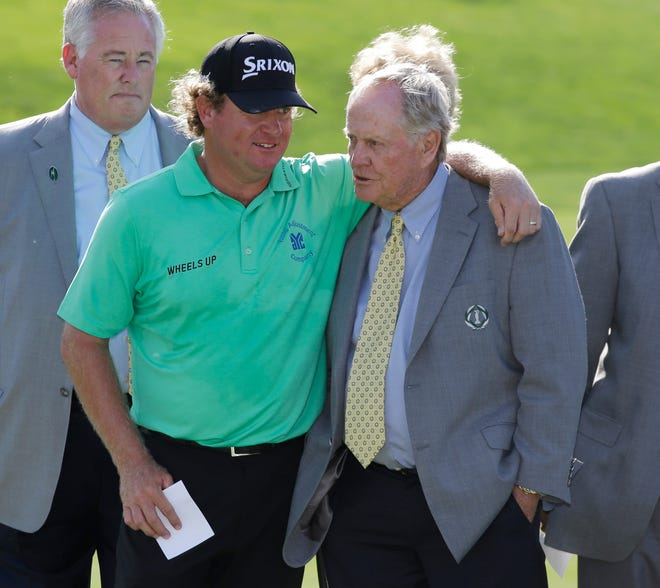 Jack Nicklaus, right, talks with William McGirt after McGirt won the Memorial golf tournament in a playoff on June 5, 2016, in Dublin, Ohio.