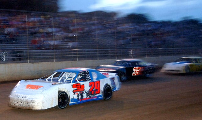 Mike Helmly (29) leads the pack in the Street Stocks Model car race at Oglethorpe Speedway Park in this file photo.