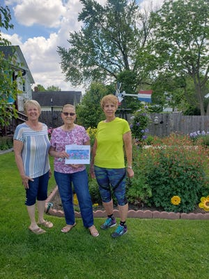 """The Garden Club of Kewanee awarded the first """"Yard of the Month"""" title Tuesday. Shown, from left to right, Garden Club President Joline Oswald, winner JoAnn Brose and """"Yard of the Month"""" co-chair Carol Appell. The Garden Club contest runs for three months during the summer. The next winner will be announced on July 1."""