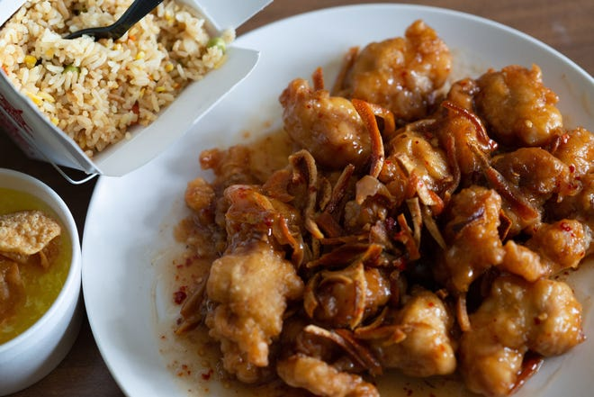 An order of orange chicken from Hunam Chinese Restaurant comes loaded with your choice of rice and a side of egg drop soup for $8.53, including tax.