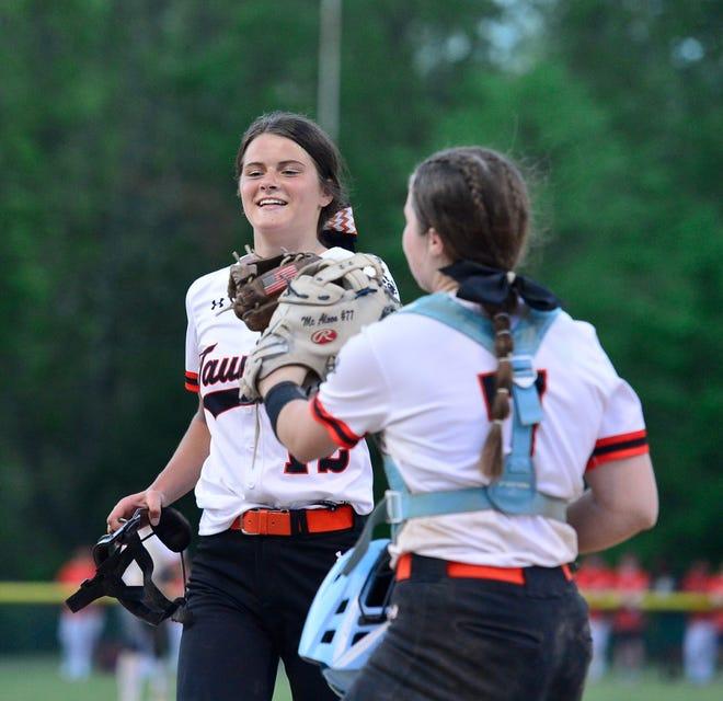 Taunton pitcher Kelsey White is congratulated by senior catcher McKenzie McAloon.
