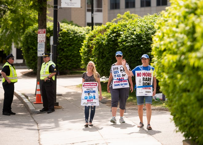 Susanne Flynn, Sally Kwasny and Jackie Giguere continue their mission on the St. Vincent Hospital nurses picket line Wednesday.