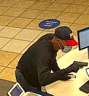 A gunman who robbed the First Horizon Bank May 8 is shown here in a surveillance video taken during the robbery at the McPherson Church Road location.