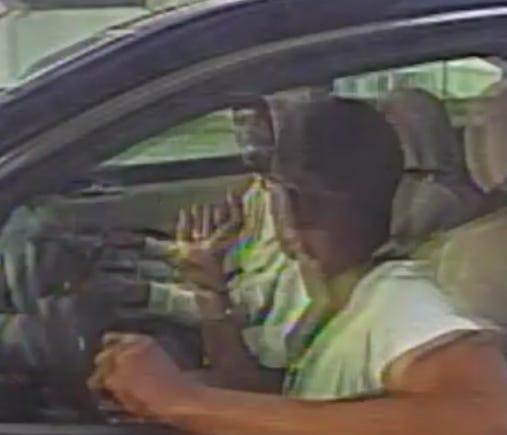 Police want to identify the man seen here in the passenger seat of homicide victim Mario Boone as Boone, in the driver seat, visits a Fayetteville ATM.