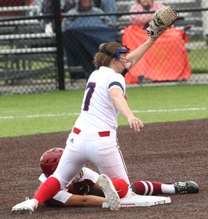 BNL shortstop Carlee Kern tags out Gibson Southern Emilee Edwards attempting to stretch a single into a double Tuesday night in the Bedford Regional championship. The Stars prevailed, 5-2.