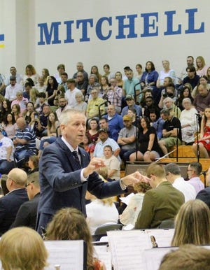 Hank Wintczak, Mitchell Jr. High/High School band director directs for the final time at the MHS graduation last month. Wintczak retired after 43 years in education, 40 of them at Mitchell.