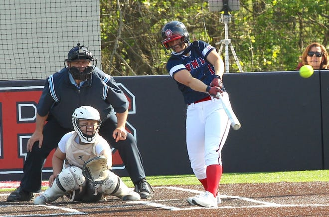 BNL sophomore Annie Waggoner laces a hit against Bloomington North. Waggoner has 8 home runs and is 20-1 as a pitcher going into the Center Grove Semi-State on Saturday.