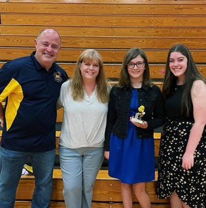 Needmore sixth-grader Sophie Osmon, second from right, received the Cole Winnefeld Bee Amazing award, given to a Needmore student who embodies the traits of Cole, a Needmore student who bravely fought cancer for six years before his passing in 2015. Also pictured are Mike, Carol and Lauren Winnefeld.