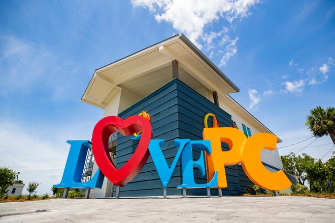 """The new welcome center in downtown Panama City will open this month and features a conference room, public showering facilities, and a 500-square-foot bay-facing open deck. It also features colorful life-size letters for """"LovePC"""" — with a red heart replacing the second letter."""