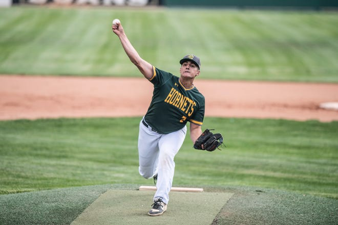 Pueblo County High School's Cole Martino releases the ball on a pitch during the matchup with Pueblo West on Tuesday June 1, 2021 at Andenucio Field.