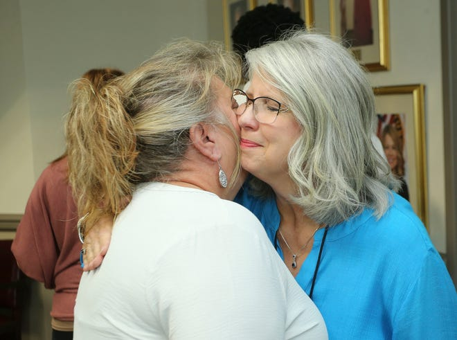 Tami Rector hugs Assistant City Clerk Debby Clements during Clements' retirement party at Tuscaloosa City Hall Wednesday, June 2, 2021. [Staff Photo/Gary Cosby Jr.]