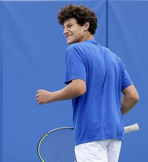 Gahanna Lincoln sophomore Brandon Carpico reacts after winning a point during the Division I state singles tournament May 29 at Lindner Family Tennis Center in Mason. Carpico captured the Lions' first state championship.