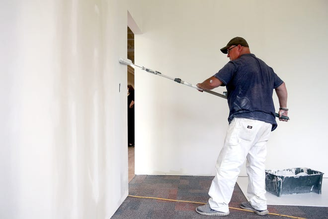 Greg Sewell with KC Coatings paints the walls inside a conference room at the Mifflin Township operations building May 25 in Gahanna. Mifflin Township Division of Fire and EMS administrative offices have relocated to the building, 400 W. Johnstown Road.