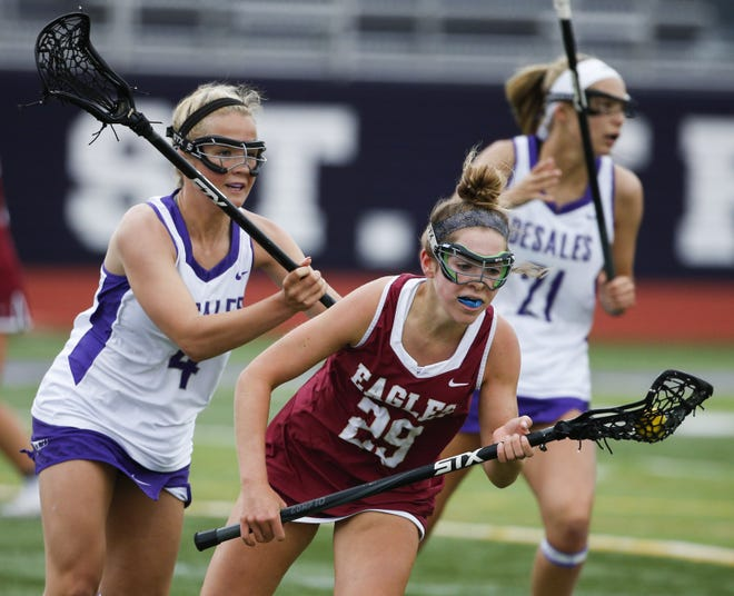 Carly Henry (29) and Watterson finished 17-6 with a 14-13 loss to Cincinnati Mariemont in a Division II state semifinal June 1 at Centerville.